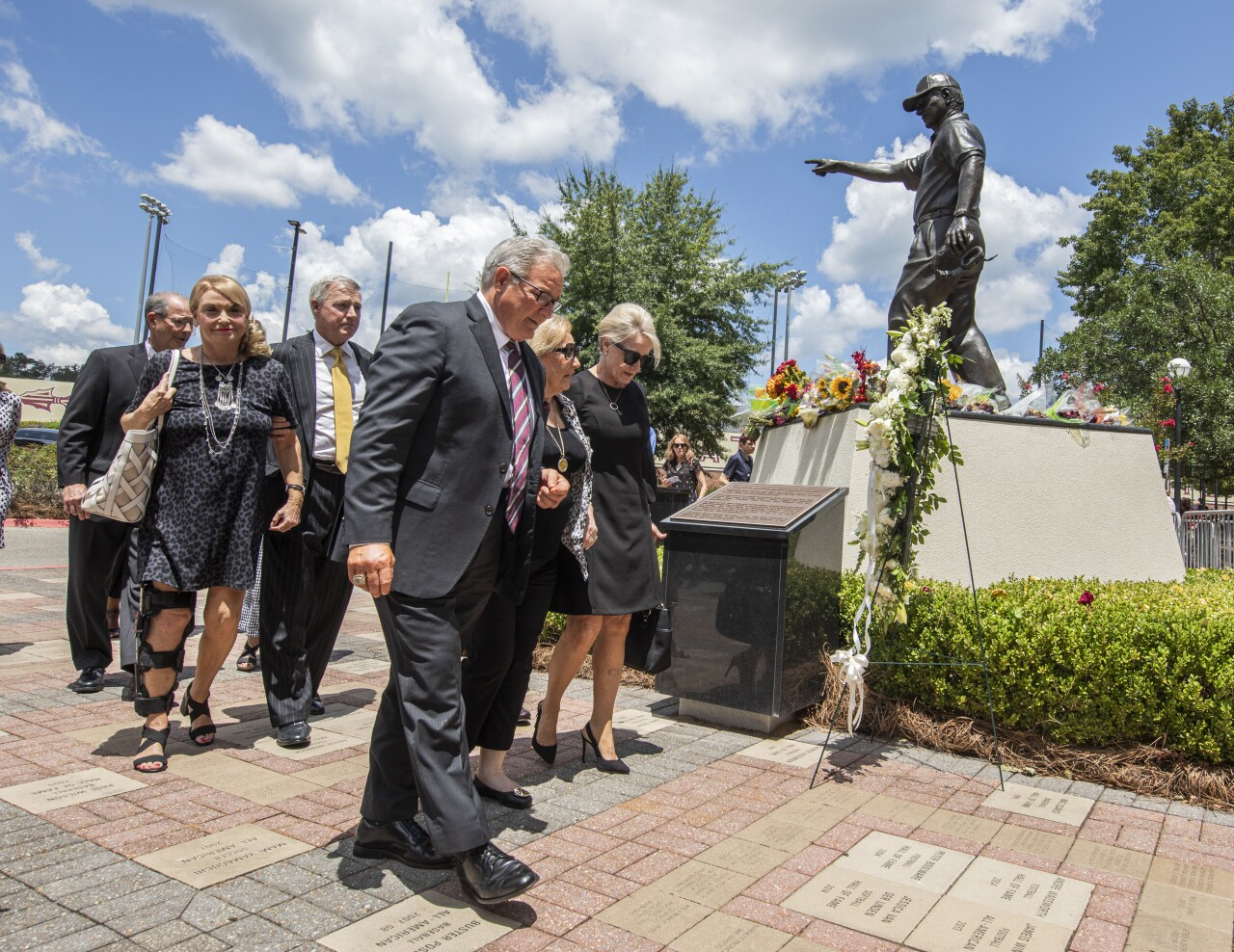 Ann Bowden passes by statue of husband Bobby Bowden outside Doak S. Campbell Stadium at Bobby Bowden Field, Aug. 13, 2021