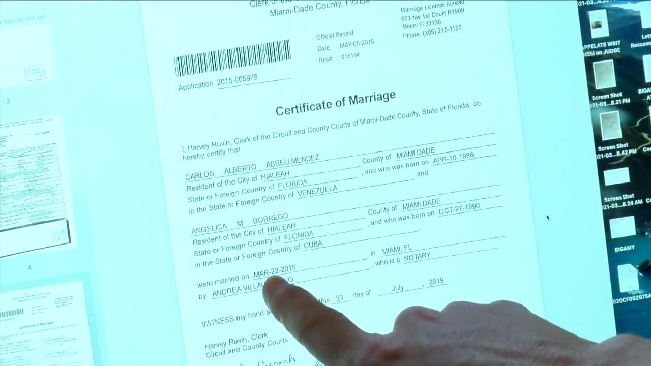 Audra Clemons points to Miami-Dade County marriage license showing Carlos Alberto Abreu Mendez married to someone else
