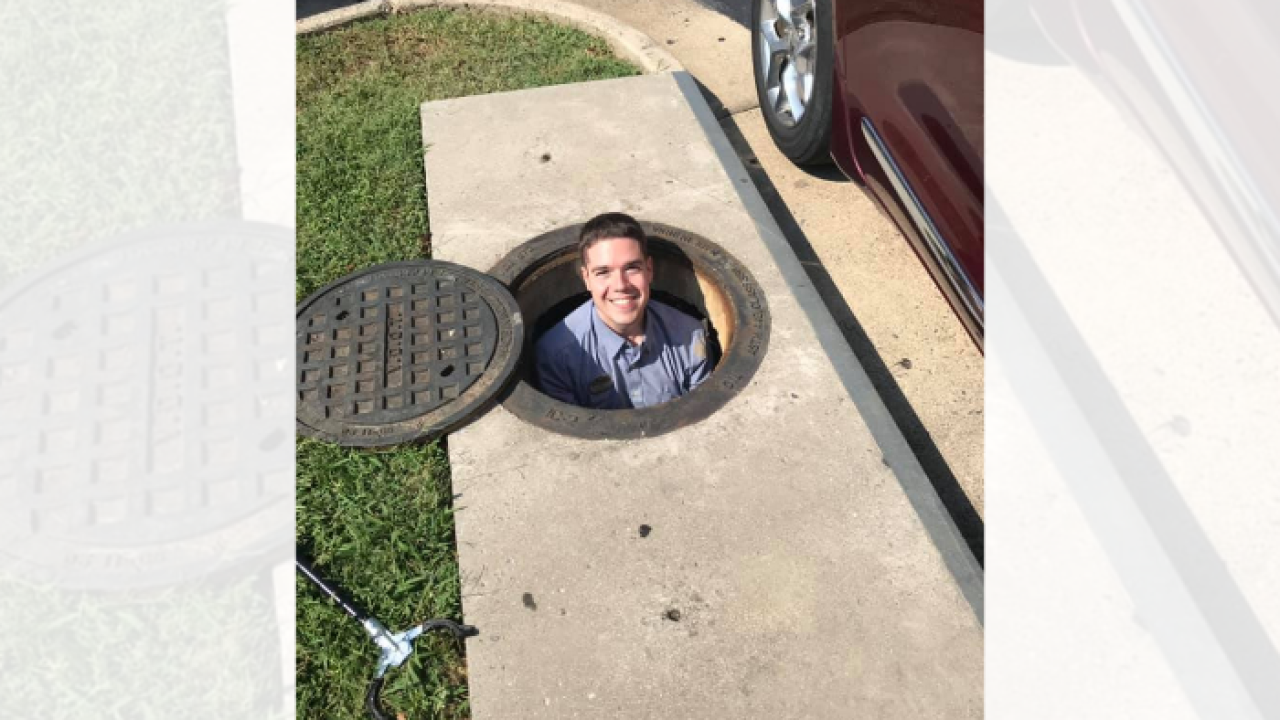 Chick-fil-A employee saves the day after woman drops phone into manhole