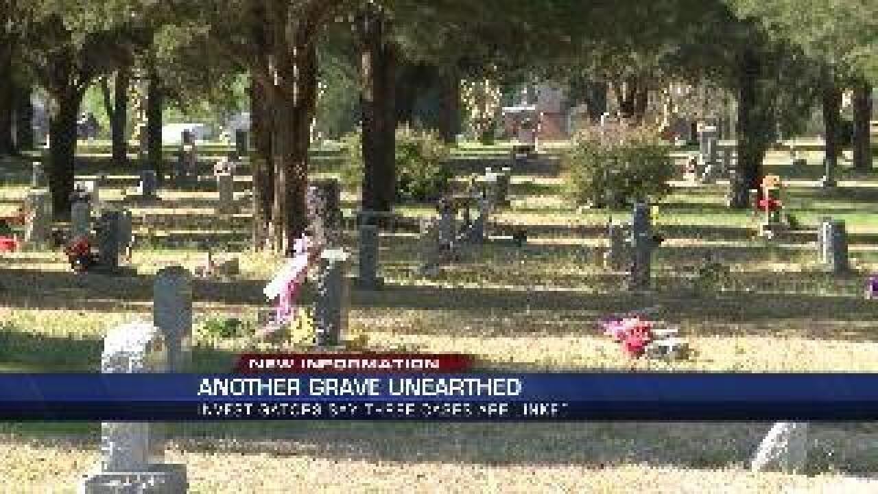 Man discovers mother's grave dug up, in wave of similar crime