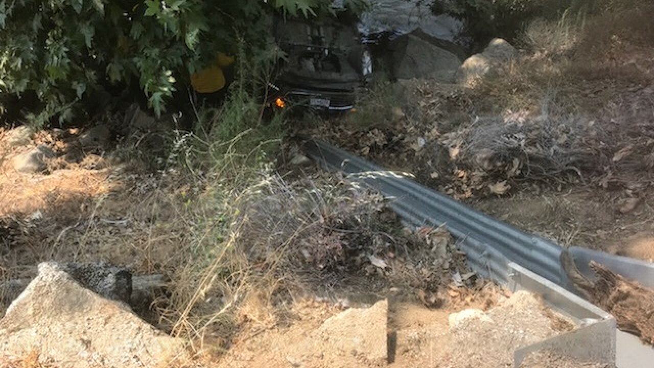 Car veers off the road on the side of the Kern River