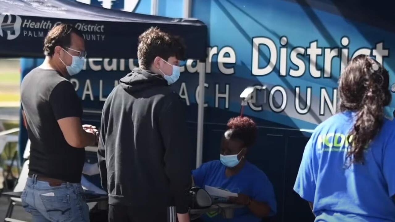 The Health Care District of Palm Beach County administers the COVID-19 to a student during the 2021_22 academic year.jpg