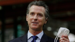 gavin_newsom_hold_mask_ap.jpg