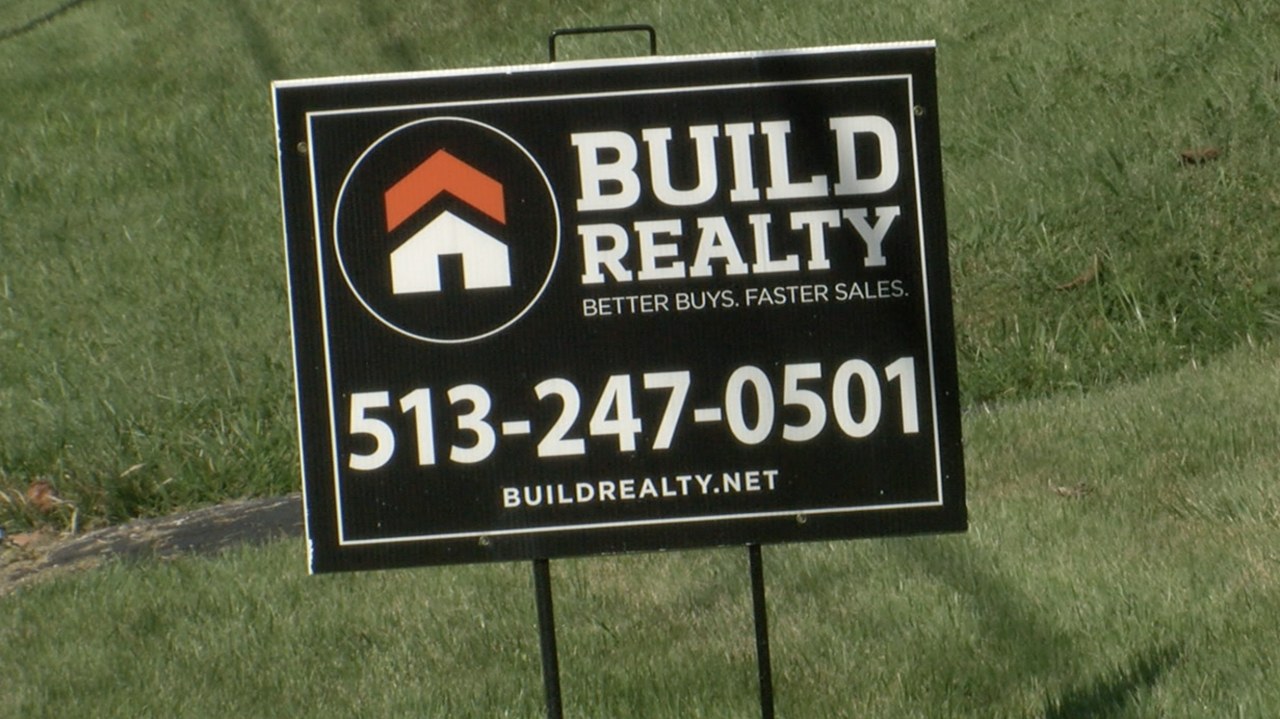 A Build Realty sign in front of a Madisonville home.