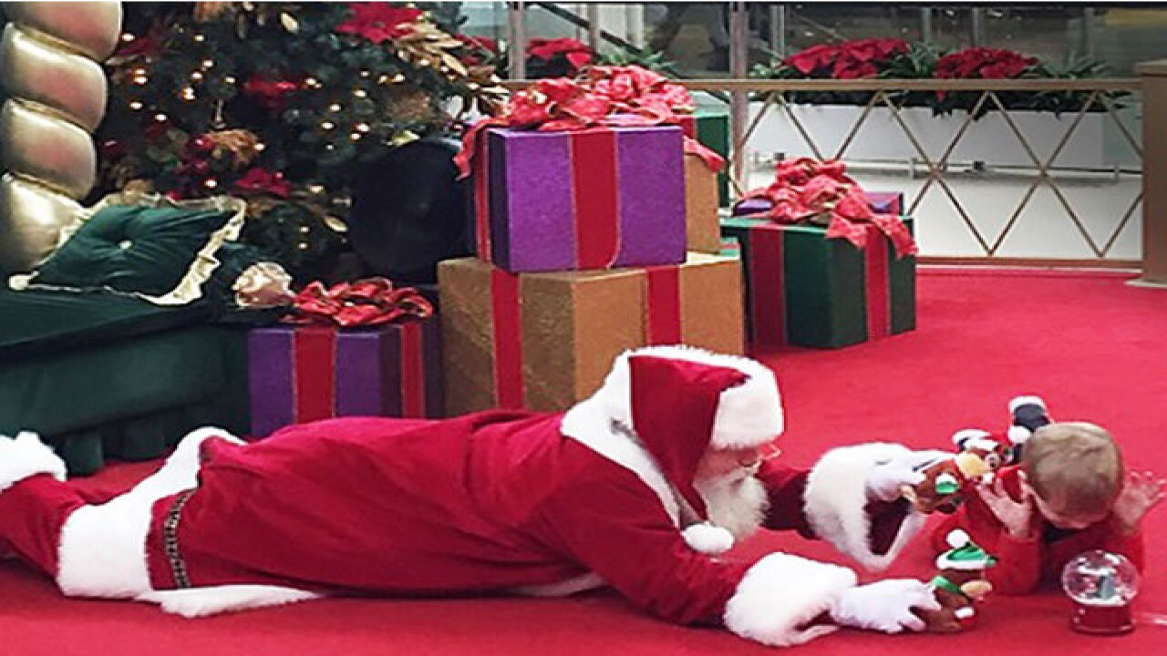 Why is Santa lying on floor in Christmas photo?