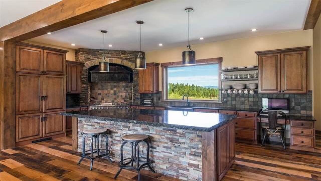 Evergreen home features meadow, mountain views