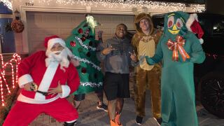 WATCH: Dancing dads dress up in Christmas suits, bring joy to neighborhoods