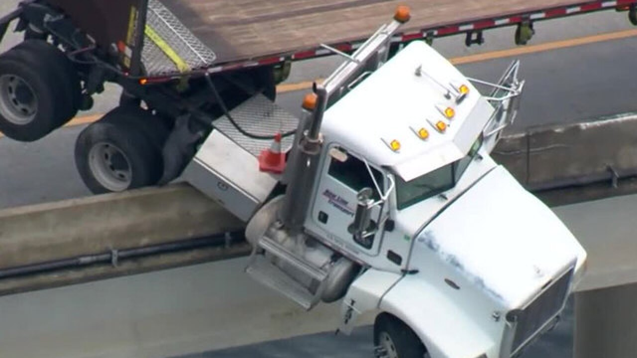 Wreck leaves semi dangling over bridge in Manatee County, Florida