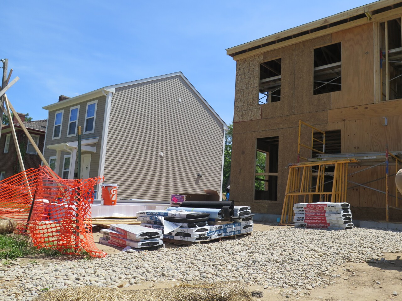 Allied Construction Industries and Habitat for Humanity of Greater Cincinnati teamed up to build the single-family home with tan siding, on the left, and the duplex under construction on the right.