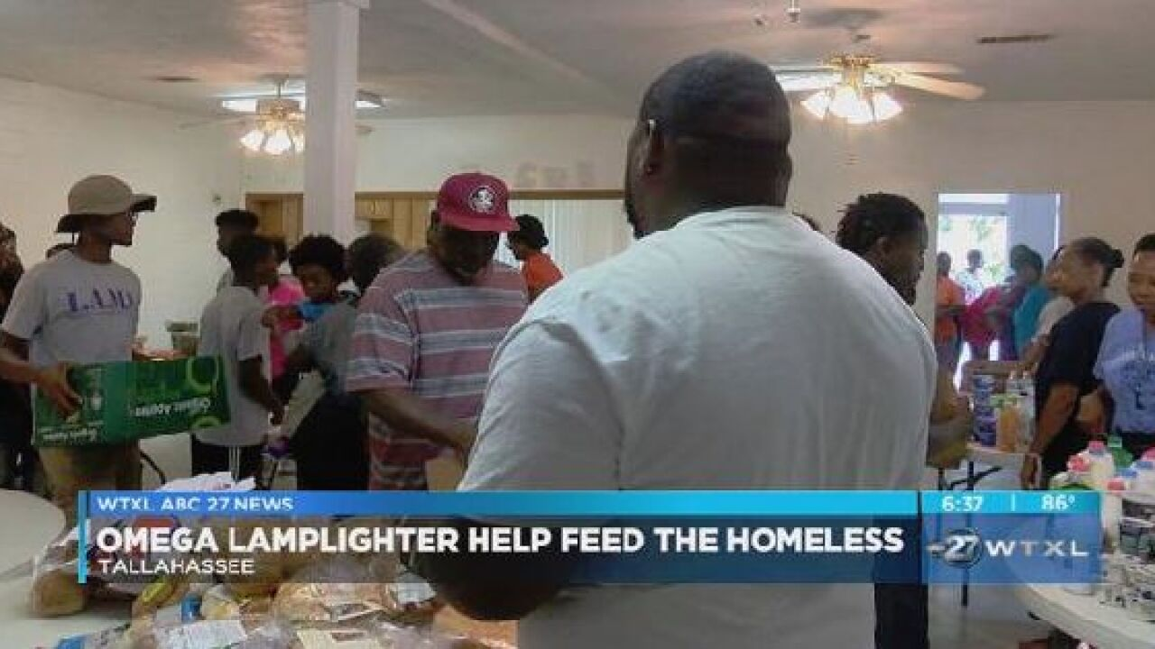 Omega Lamplighters help feed the homeless