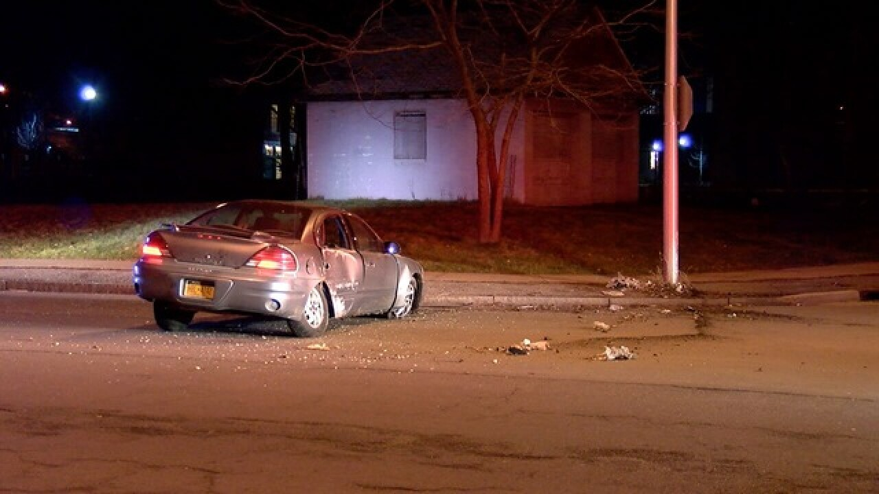 Car hits pole; occupants run away