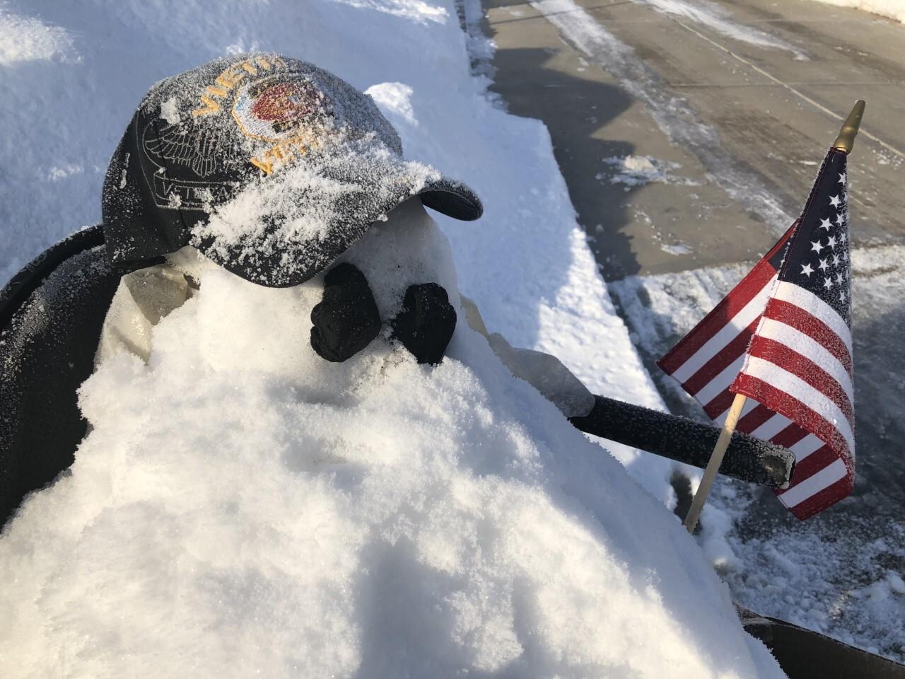 snowman of disabled vet holding US flag