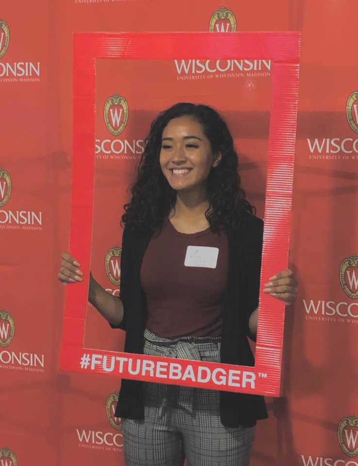 Rosie Santoyo-Maciel posing with a 'Future Badger' sign. She will attend UW-Madison in the fall of 2020.