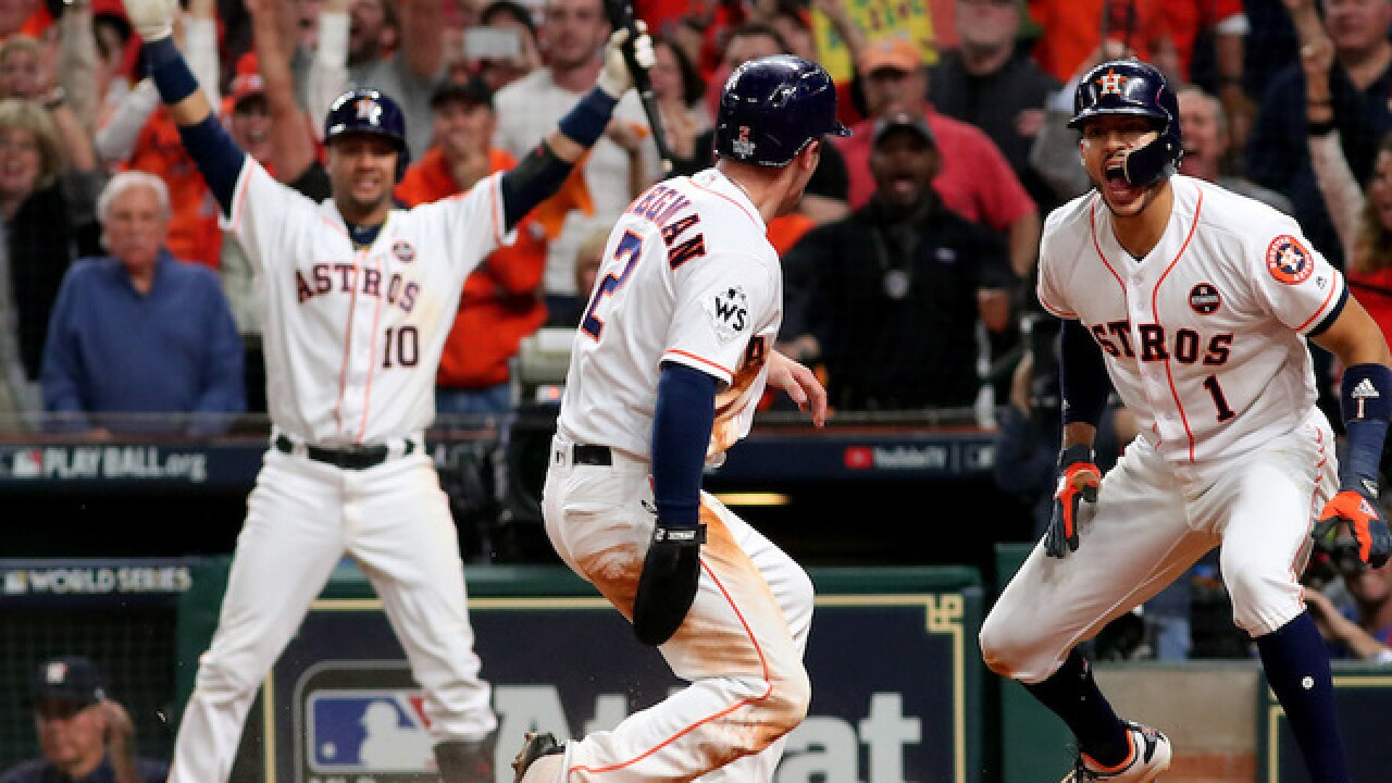 Astros down Dodgers 13-12 in Game 5
