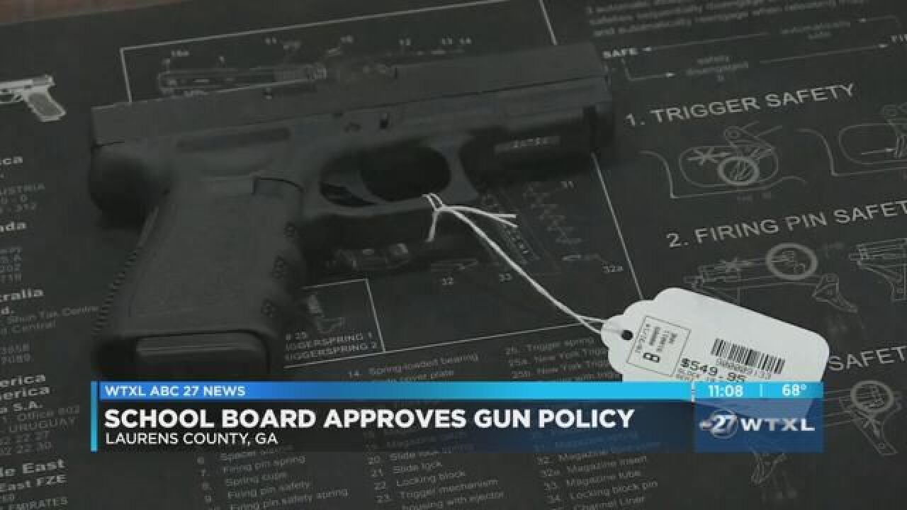 Georgia school system will let staff carry guns