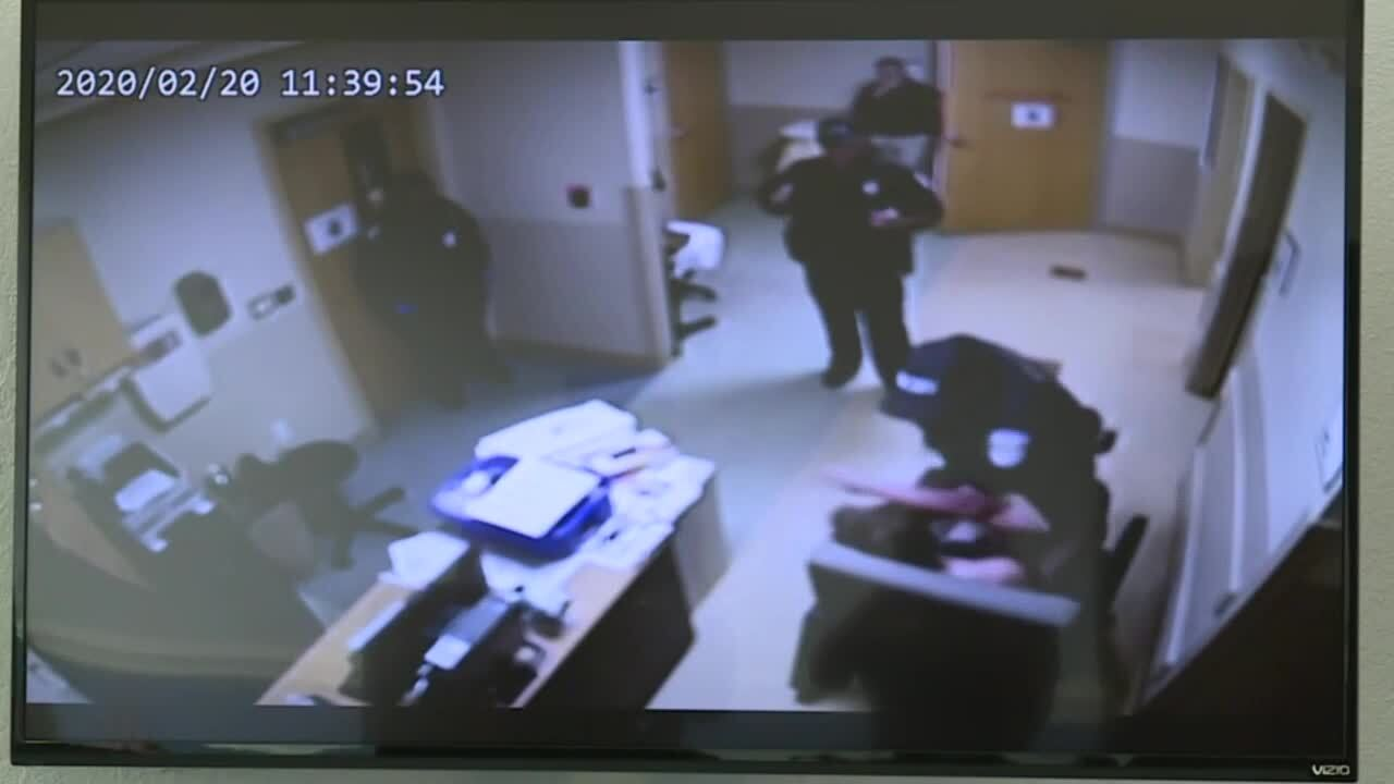 Officer Albert Eckrode seen on surveillance video punching man in chair at Lawnwood Regional Medical Center