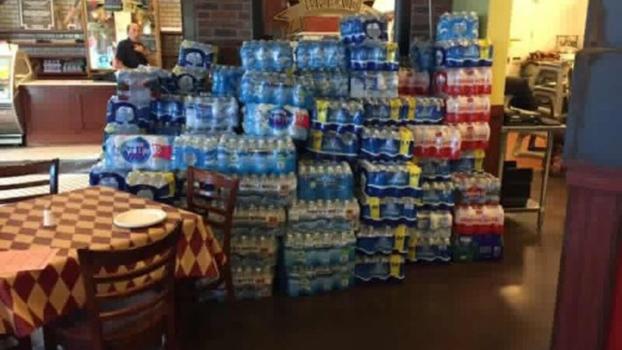 Metro Pizza collecting water bottles for homeless