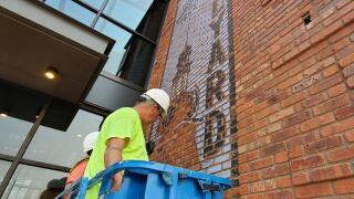 walldog artists paint mural