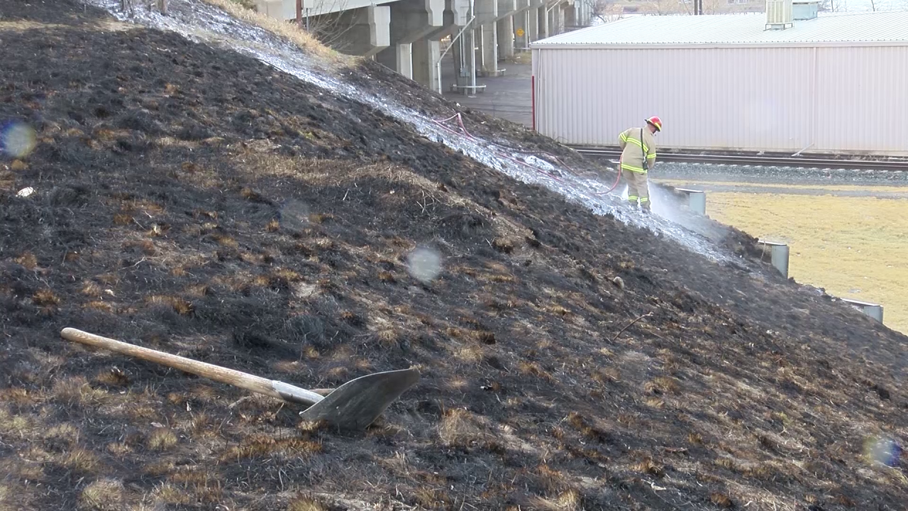 Crews tackle grass fire along 10th Avenue South
