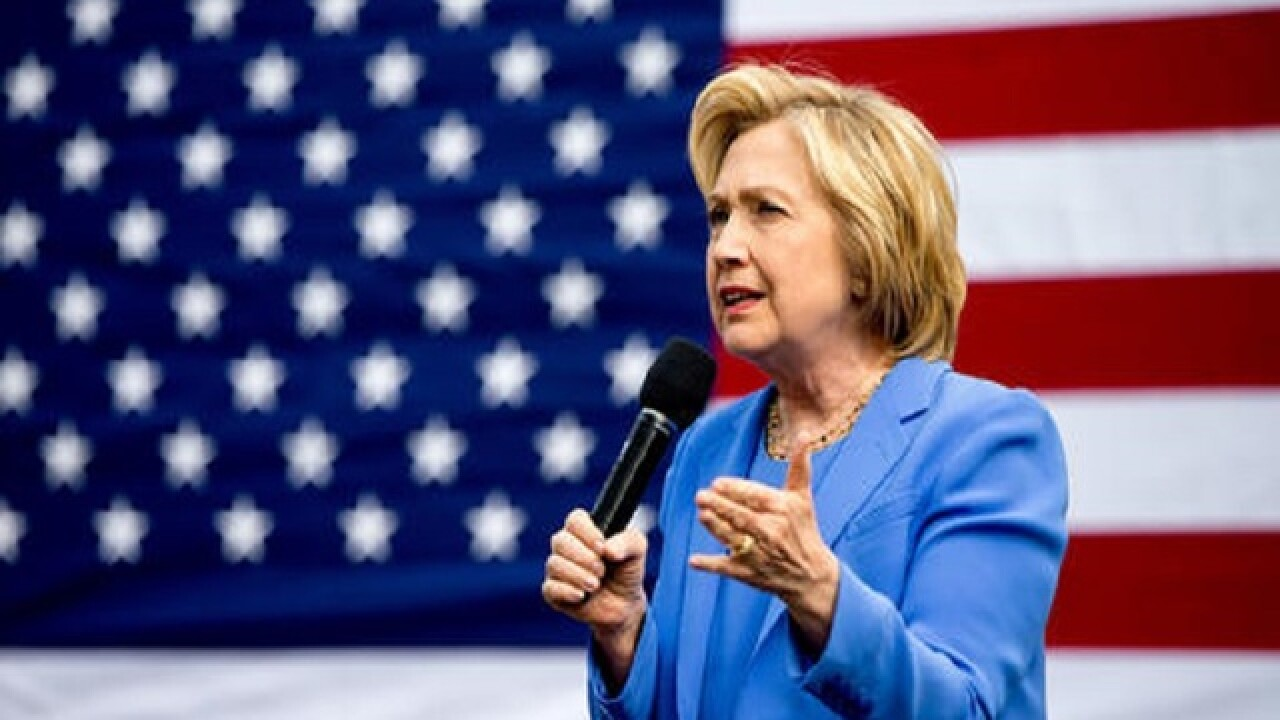 Clinton woos Kentucky voters day before primary