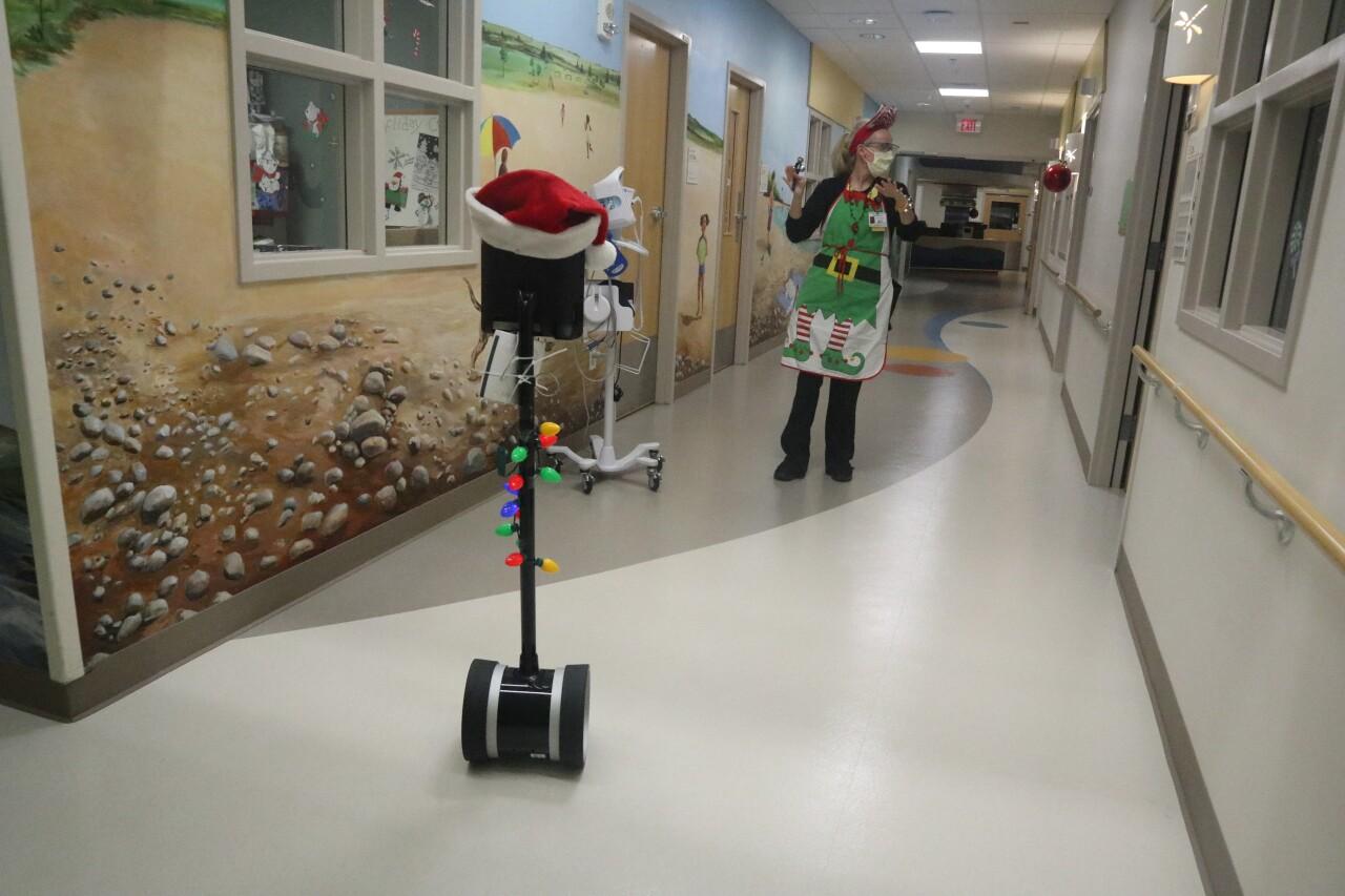 """Santa """"robot's"""" elves helping him navigate halls at Bronson Children's Hospital"""