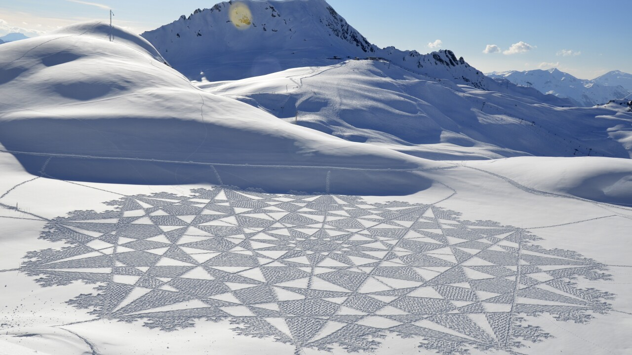 Artist uses snow as canvas for massive geometrical designs