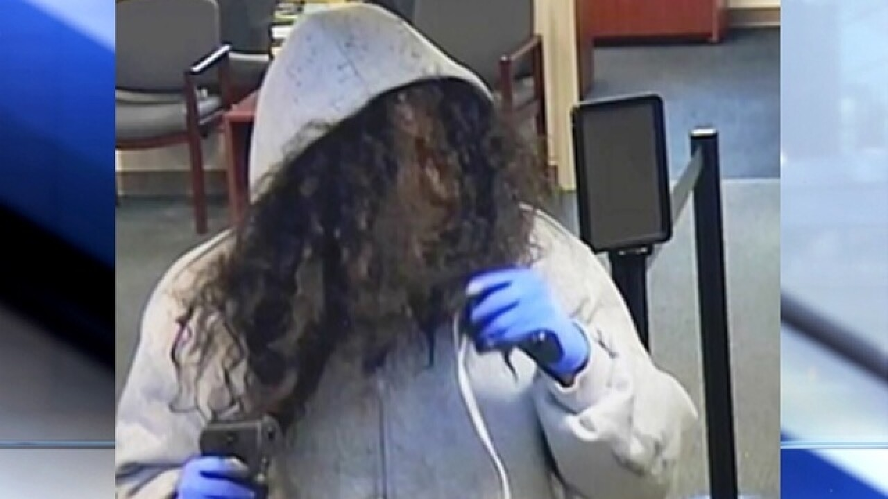 Man with hair blocking face robbed Hyde Park bank, Cincinnati police say