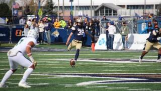 Blake Glessner kicks off the ball to start the game
