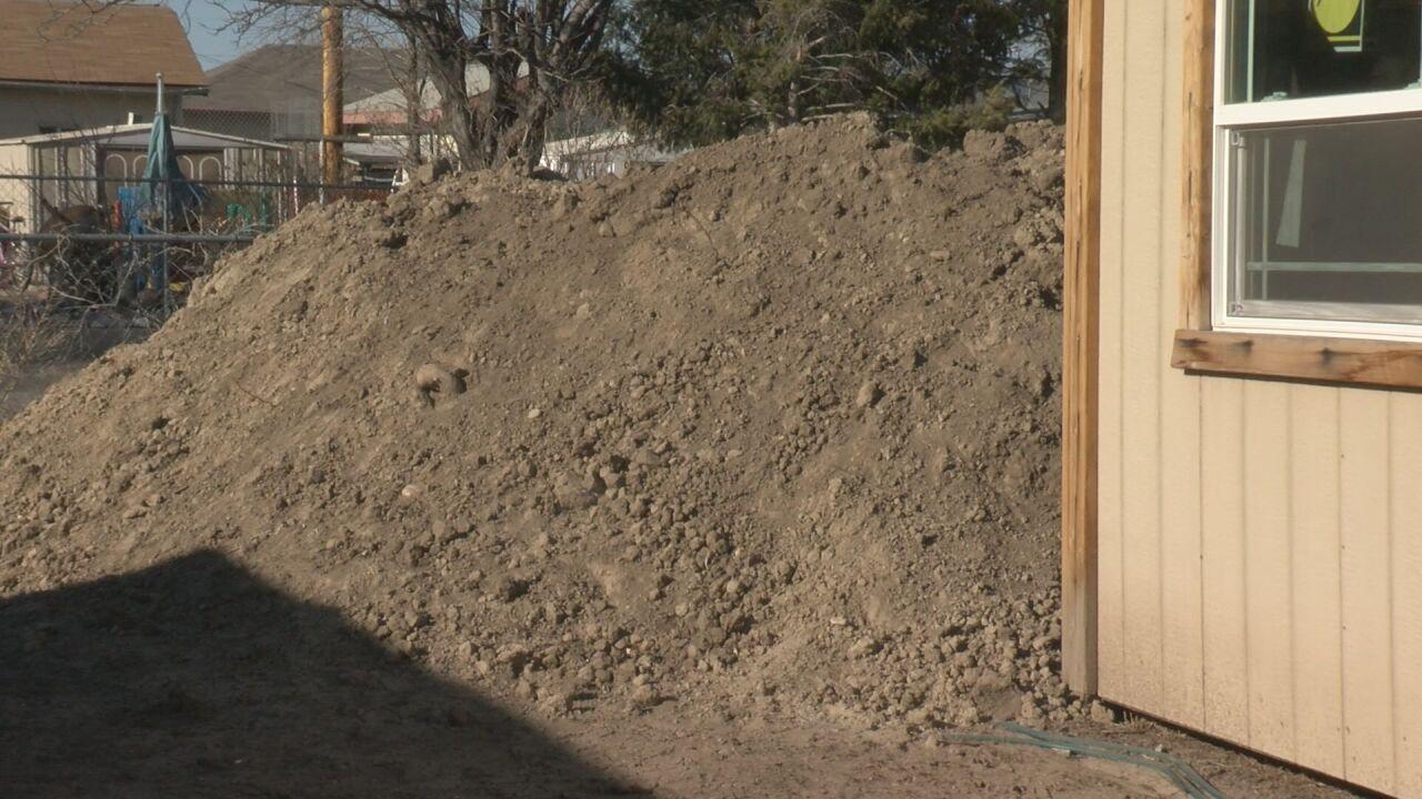 Dirt piles outside the Dunn family home