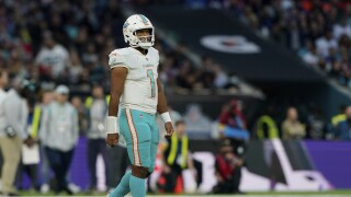 Miami Dolphins QB Tua Tagovailoa walks off field after loss to Jacksonville Jaguars in London in 2021