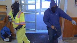 Photos: Police investigate bank robbery inHampton