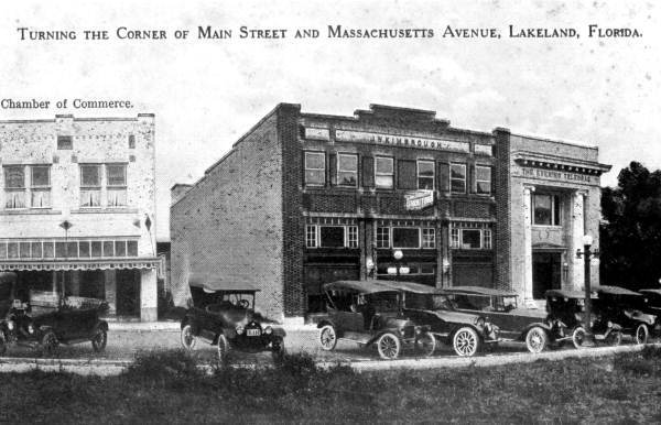 Automobiles parked in front of buildings.jpg