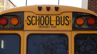 A vehicle passed a stopped school bus, nearly hitting a child. So two bus drivers boxed them in