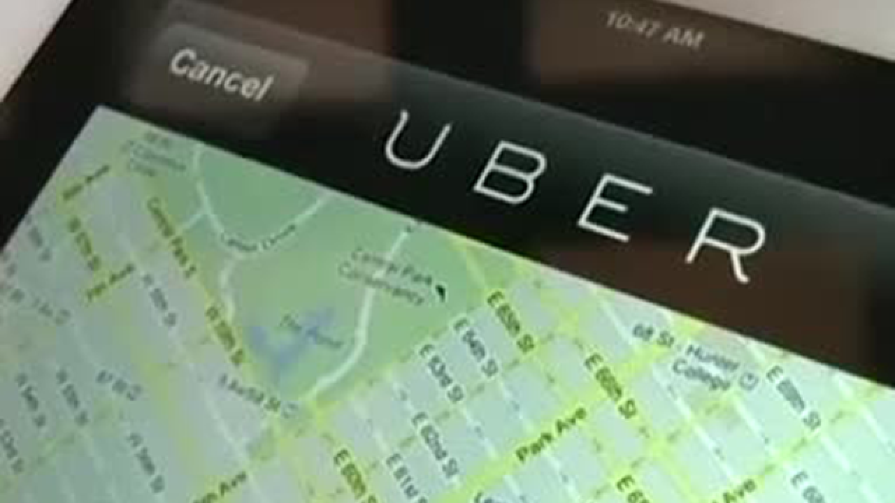 Uber driver says woman held her hostage