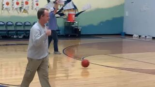 South Jetty news editor Dan Parker sank a halfcourt shot Feb. 14 at the Port Aransas Marlins game, winning $100 he promptly donated back to Project Graduation.