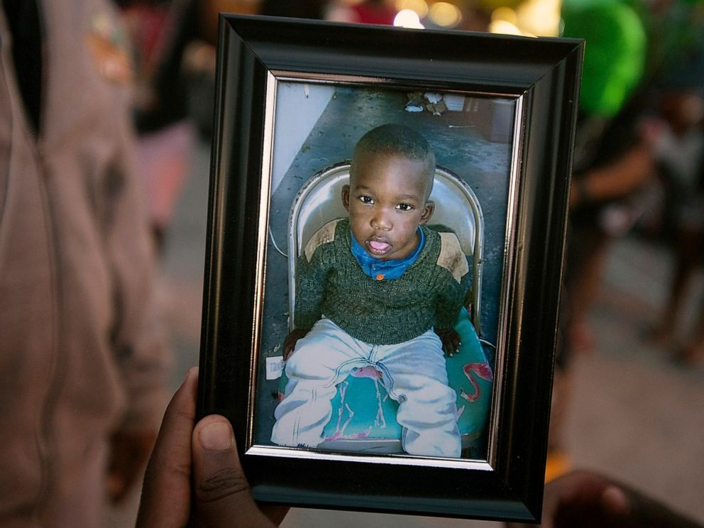 A photo of Noah Sneed is held during a gathering to honor his life with a candlelight memorial in front of the Ceressa's Enrichment and Empowerment Academy in Oakland Park, Fla., July 30, 2019 (Michael Laughlin/Sun Sentinel/TNS via Getty Images).