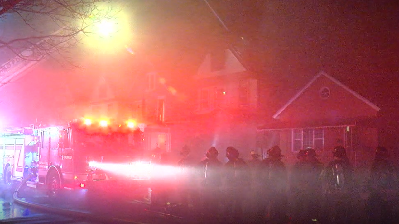 Buffalo firefighters work house fire on Vermont Street late Monday evening.