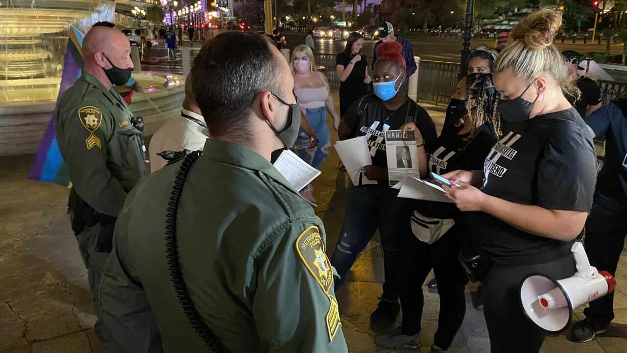 A small group met face to face with some Las Vegas Metro police officers on Tuesday night in front of the Venetian hotel and casino before a short march to demand justice in another high profile police shooting death.