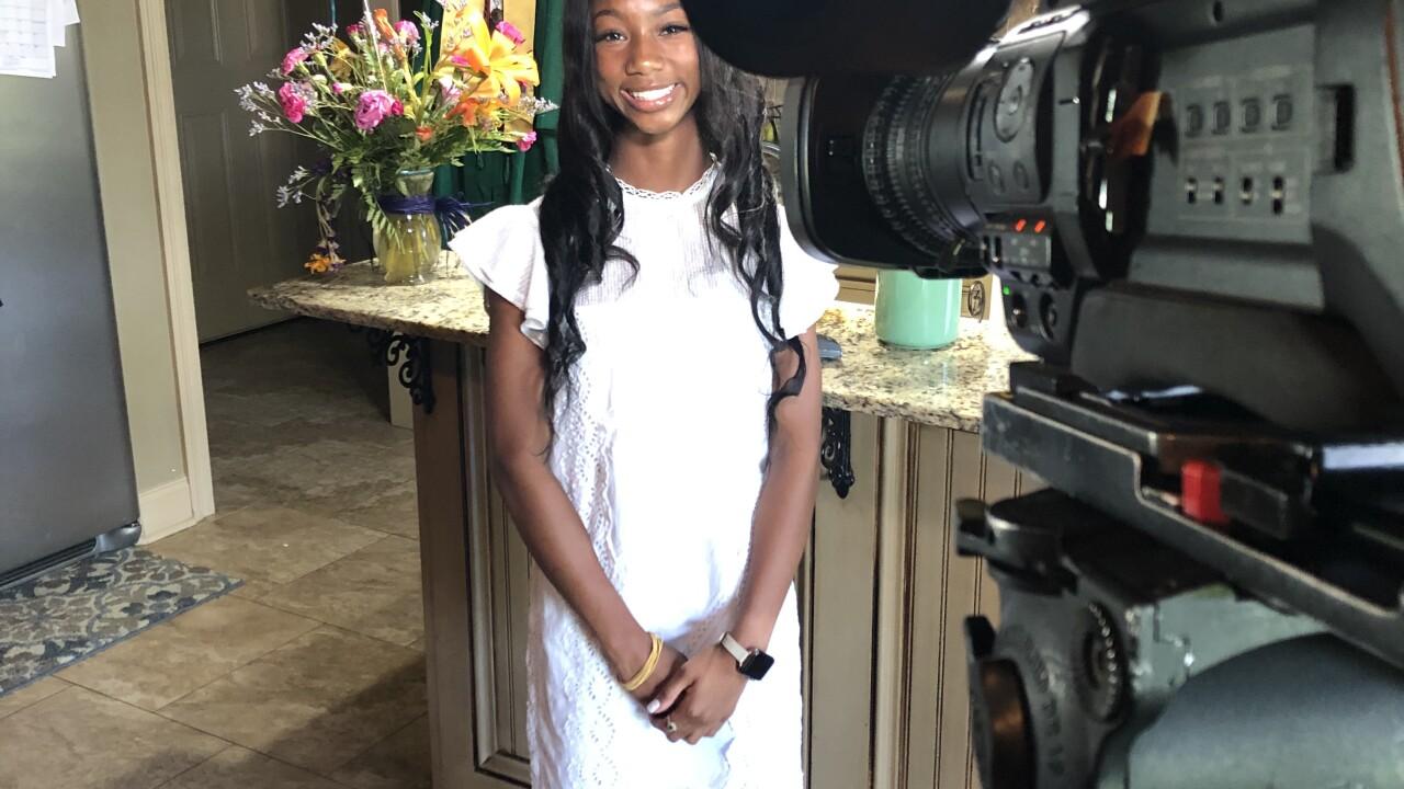 Kaitlin Harris graduating from Lafayette High School