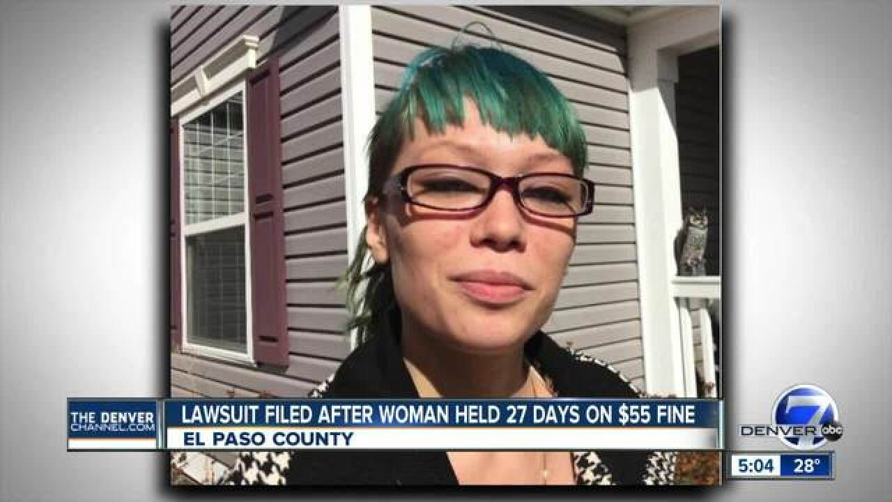Suit: Woman granted bond kept in jail over $55