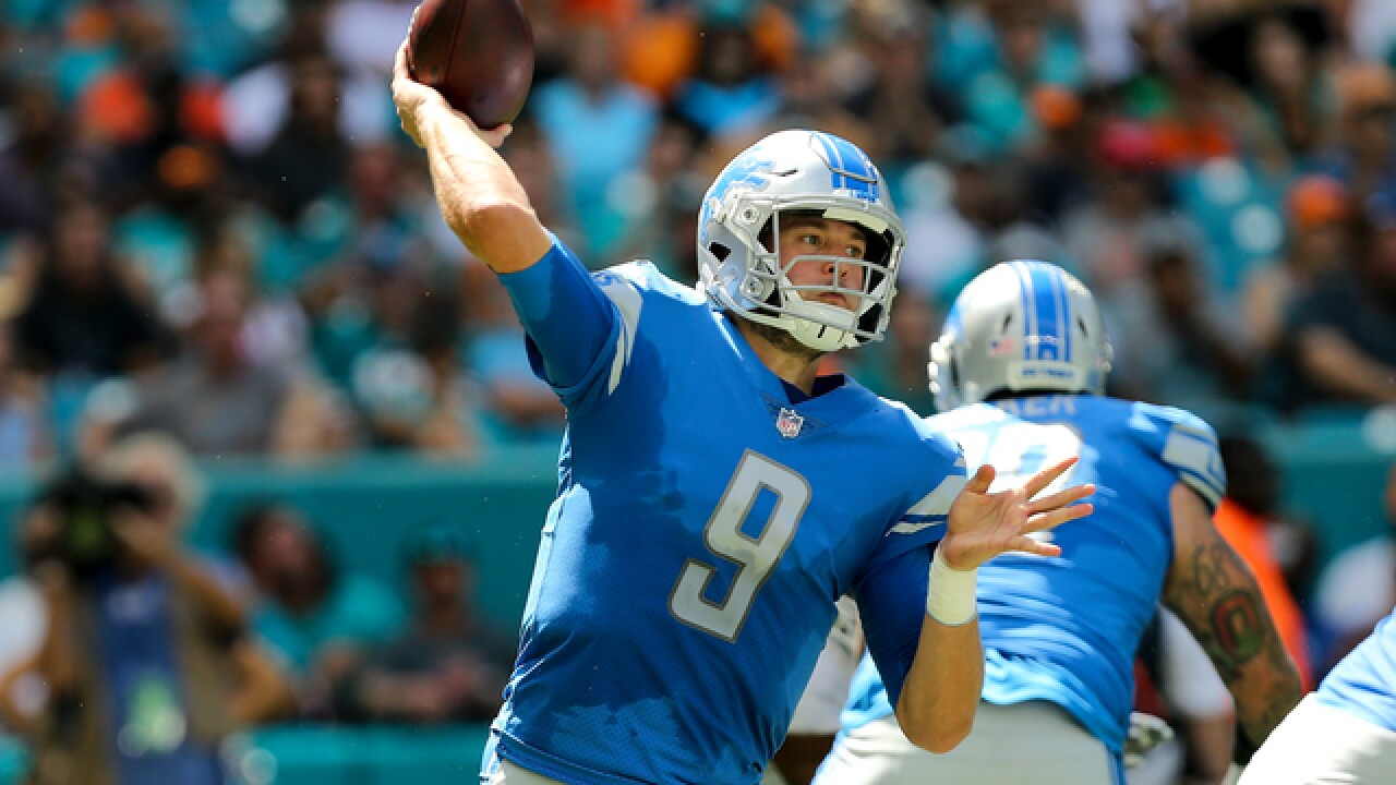 Stafford, Roberts lead Lions over Dolphins