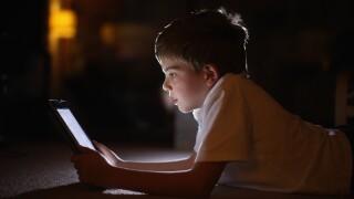 Child Reading on iPad