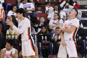 Trae Hugs and Cayden Redfield celebrate a charge taken by a teammate.jpg