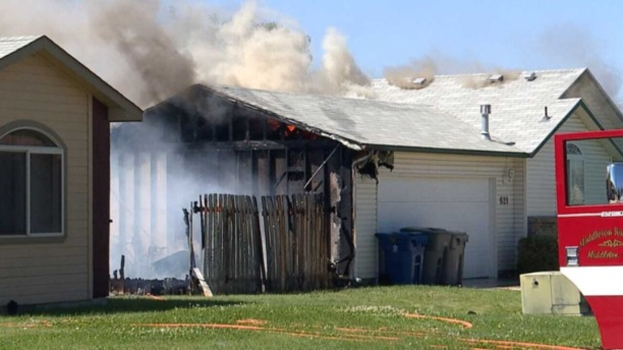 Two-alarm fire damages Middleton home