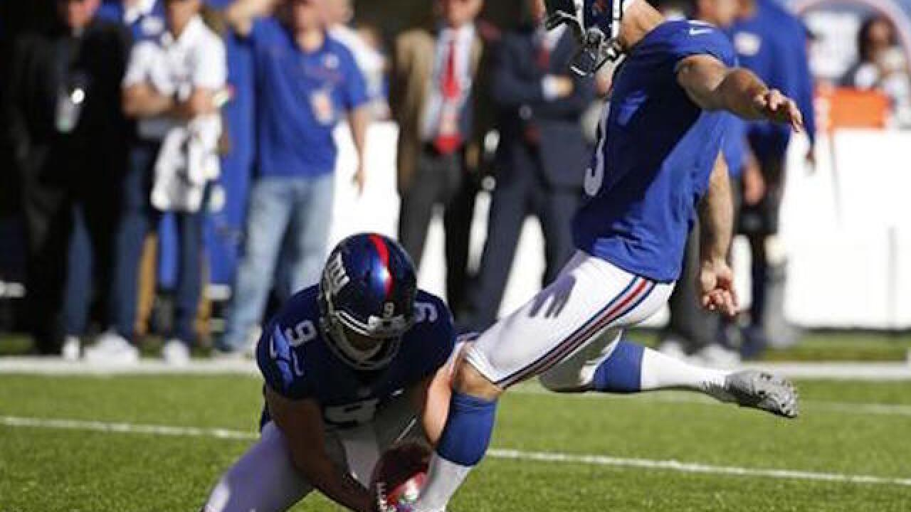 Police docs: Giants kicker Brown said he abused wife