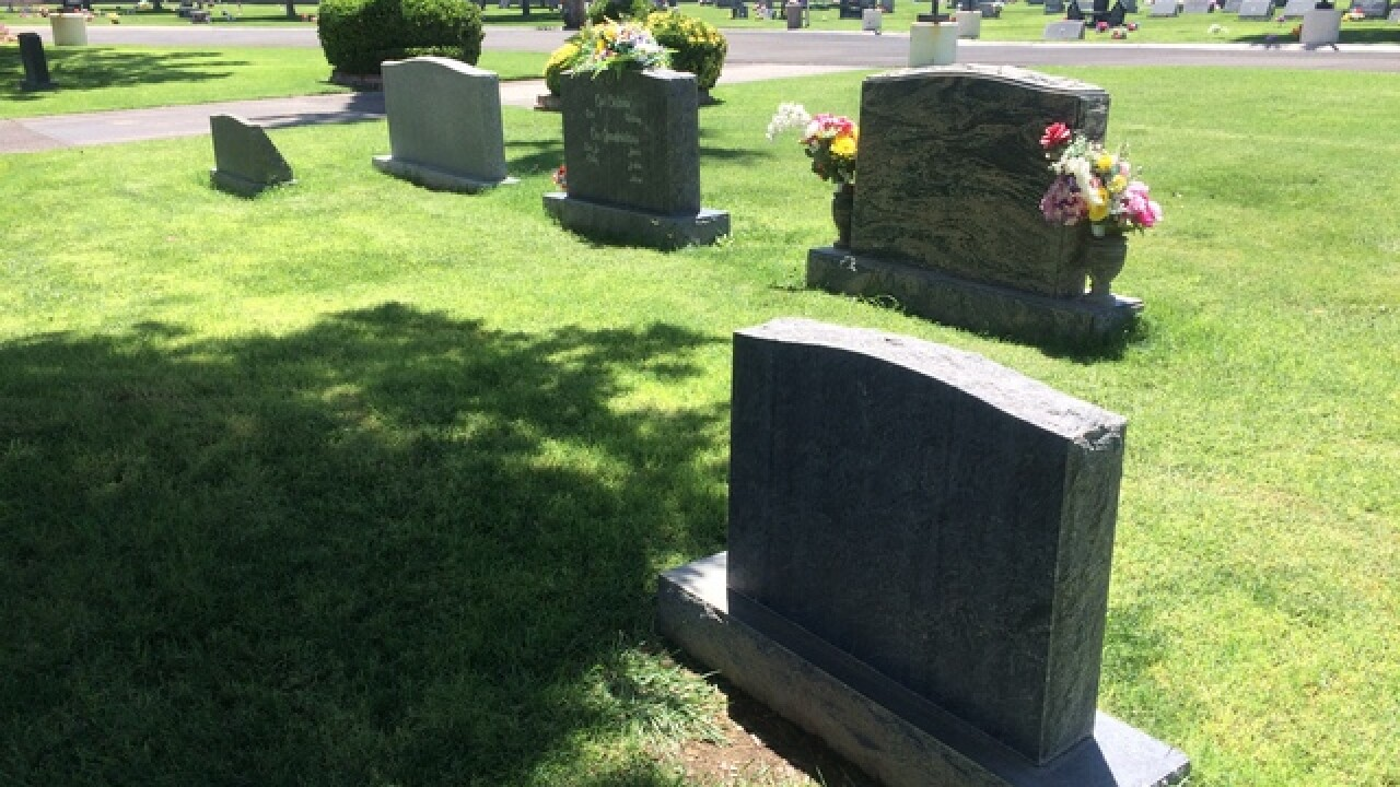 Woman says U.S. flags were stolen from gravesite