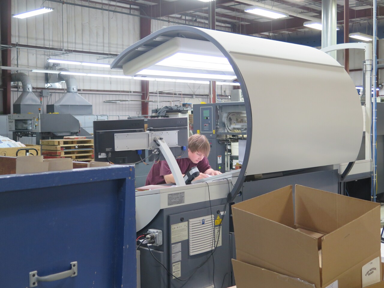 An employee works on a printing machine at JBM Packaging in Lebanon, Ohio.