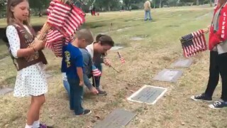Scouts leave flags at San Diego veterans' gravesites
