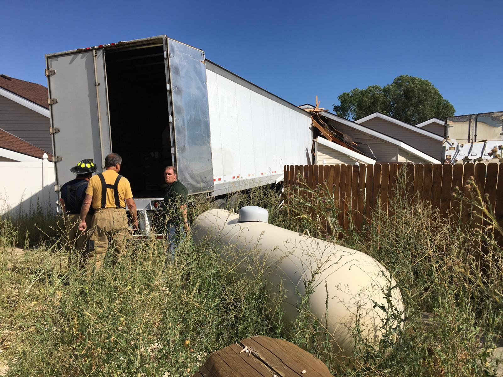 Photos: Semitrailer 'blasts' through intersection, storage buildings in Garden City