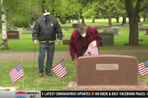 American Legion places flags on graves at Sunset Hills
